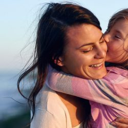 Happy mother with young daughter